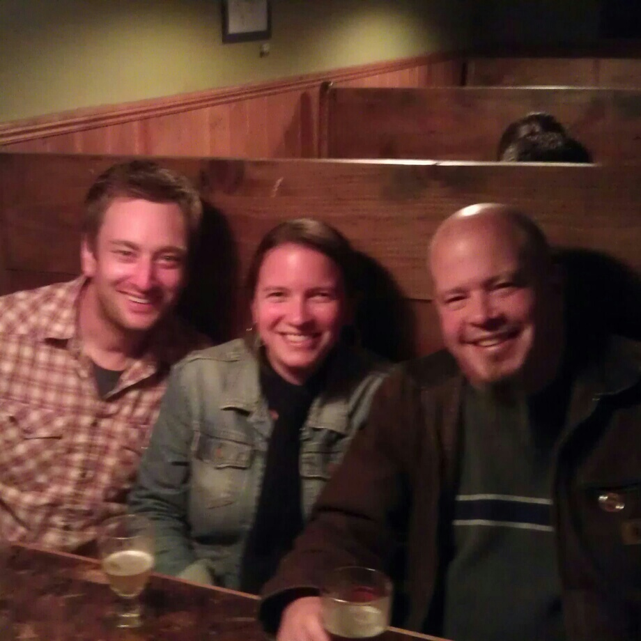 L to R: Roscoe's co-owner Jeremy Lewis with Green Dragon's Lexie and Russ during KillerBeerWeek kickoff at Roscoe's Pub