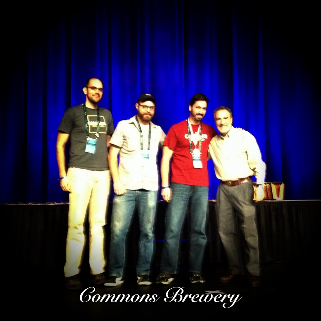 The Commons Brewery crew accepts a silver medal for their Urban Farmhouse Ale at the 2012 Great American Beer Festival
