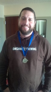 Oakshire Brewmaster Matt Van Wyk with his gold medal from FOBAB