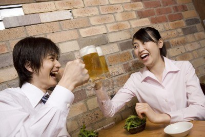 Office workers enjoying drinking beer