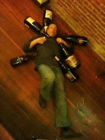 Preston Weesner with big bottles of beer