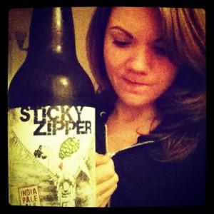 Kim Schimke of @KimsBayBrews with a bottle of Oakland Brewing's Sticky Zipper IPA