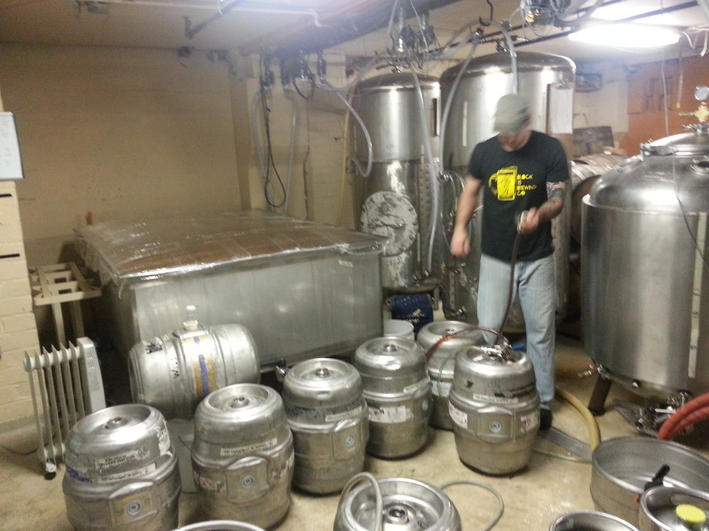 Block 15 cellarman Erik Salmi racking beer