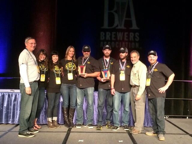 Barley-Browns-and-Baker-City-Brewing-Company-staff-under-owner-Tyler-Brown-and-Brewmaster-Eli-Dickison-accept-their-award-for-Very-Small-Brewery-of-the-Year-at-the-2013-Great-American-Beer-Festival1