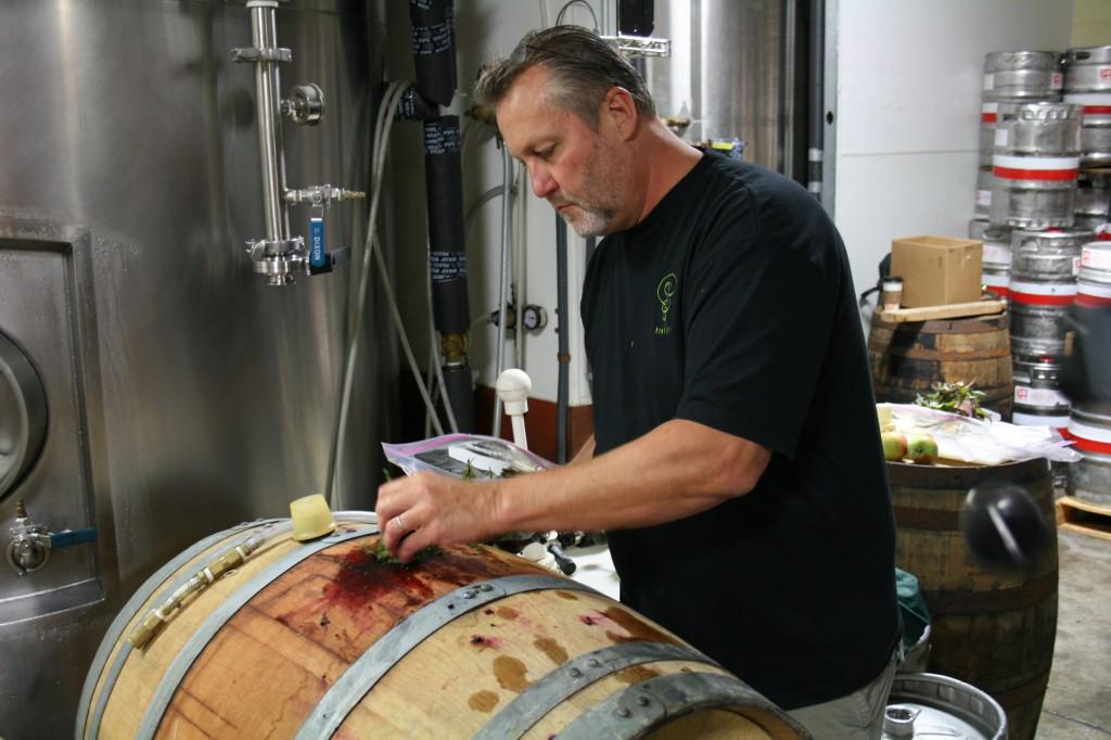 Chef Brian Scheehser Adding Blackberries To Barrel