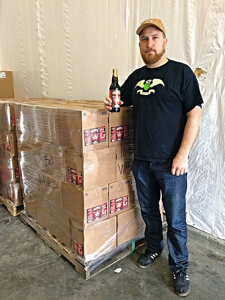 Gigantic Brewing's Ben Love overlooking the 100 cases of MASSIVE 2013 Bourbon Barrel Aged