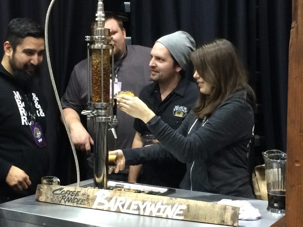 Goose Island Pouring 2014 Bourbon County Barleywine thru a Coffee Randal at 2014 FoBAB