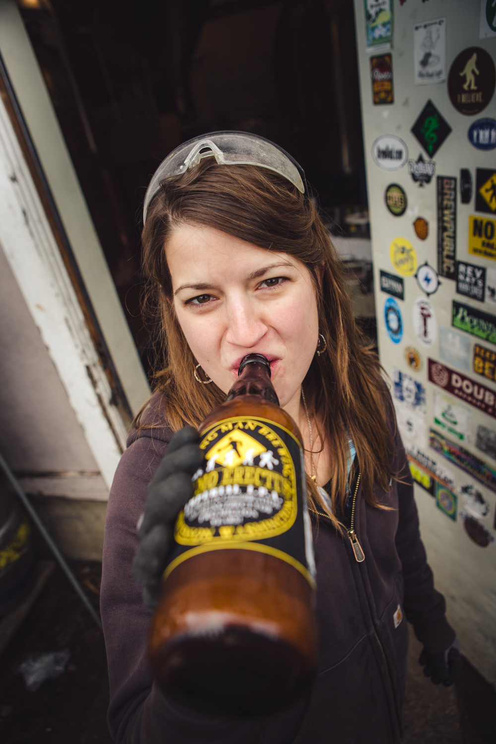 Walking-Man-Assistant-Brewer-Emily-Albaugh-takes-a-sip-from-the-first-bottle