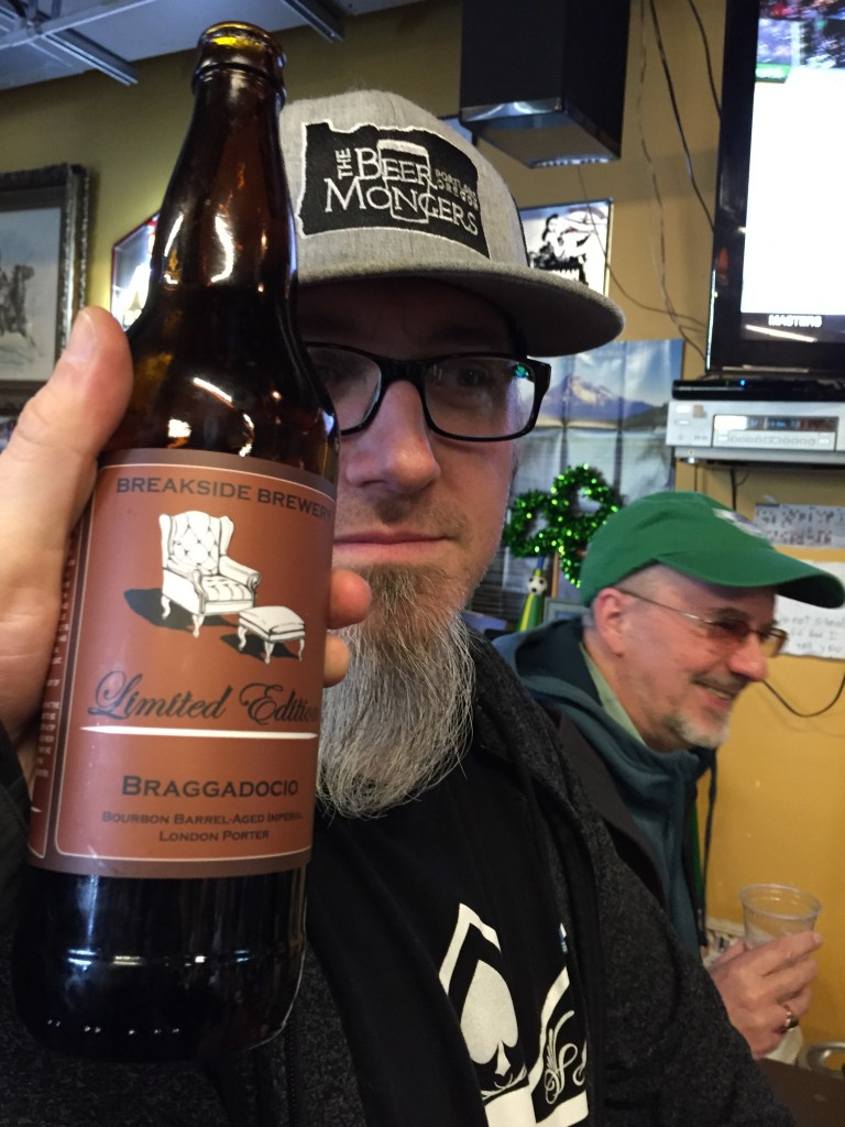 BeerMonger Chris Tappan and a bottle of Breakside Braggadocio (a collaboration beer with Stone Brewing)