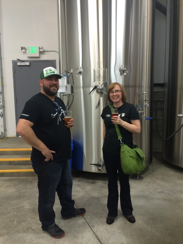 Doug Ellenberger of Everybody's Brewing and Cat Stelzer of Brewpublic admiring the new tanks
