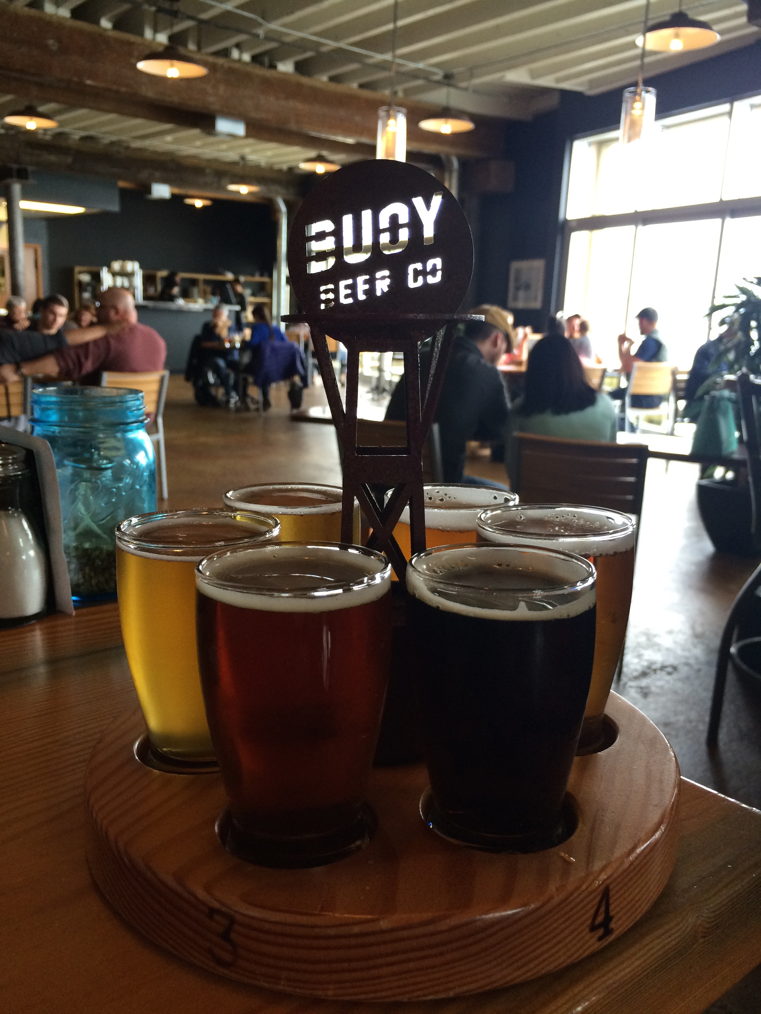 Taster Tray of Buoy Beer Co overlooking the Columbia River