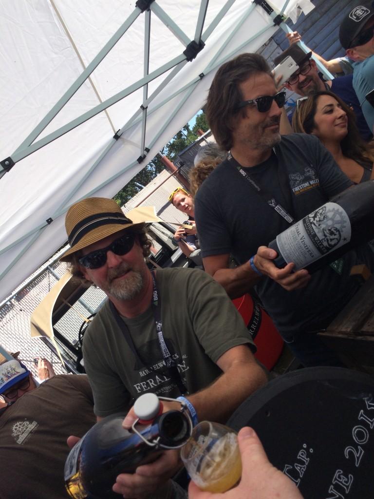 Jeffers Richardson and David Walker with magnums of Feral Vinifera at 2015 Firestone Walker Invitational Beer Fest