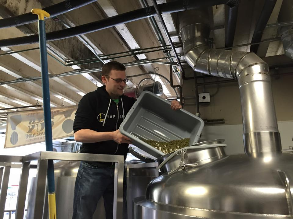 Taplister Founder Kerry Finsand adding Sorachi Ace Hops to Lemon Rye-zome at Lompoc Brewing (photo courtesy of Kerry Finsand)