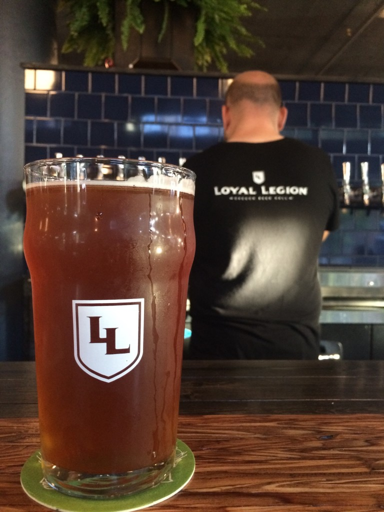 A SuperCold pour of Boneyard Bone Lite and the bar at Loyal Legion