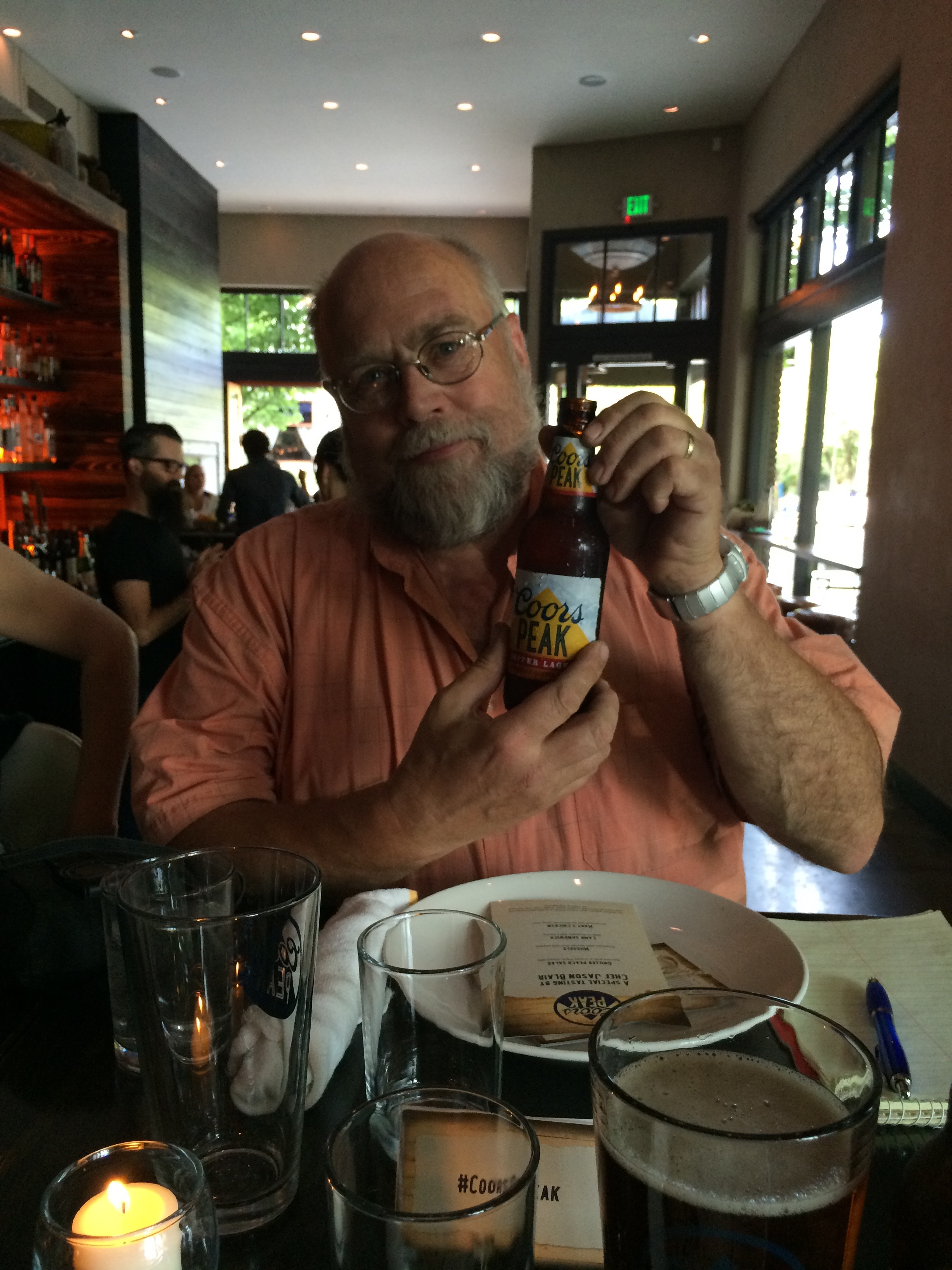 John Foyston models a bottle of Coors Peak