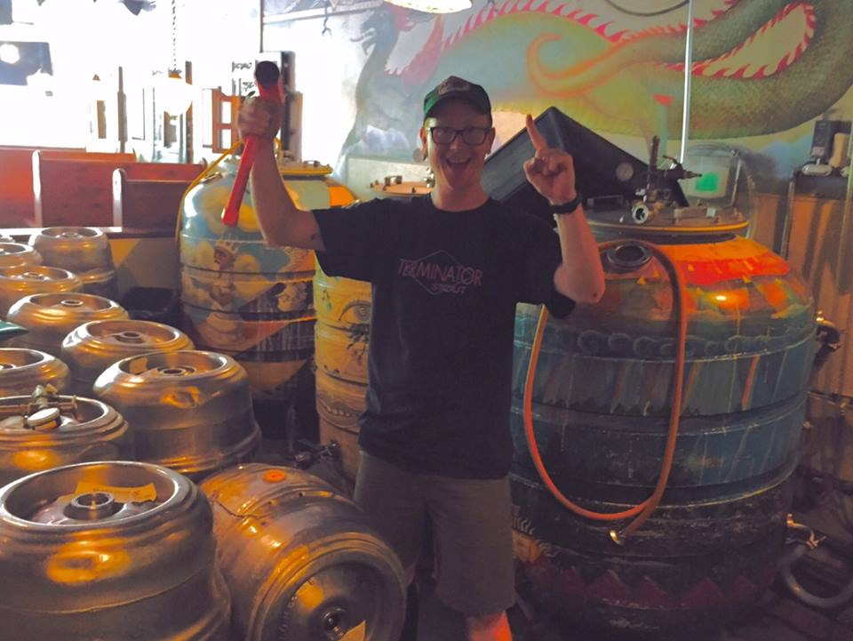 McMenamins Brewer Kyle Jungck filling McMenamins 1 Millionth Keg at Queen Anne Pub