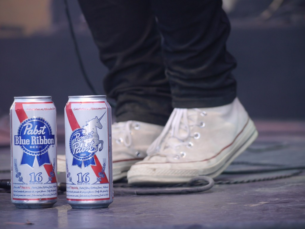Cans of Pabst Blue Ribbon on stage at Project Pabst (photo by Cat Stelzer)
