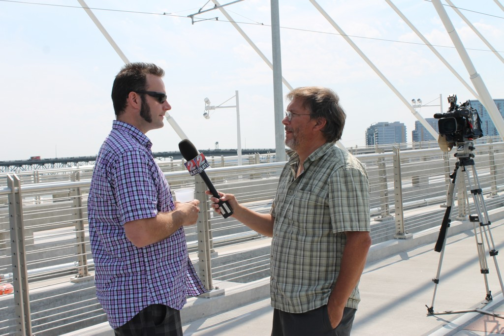 Abram Goldman-Armstrong being interviewed at Tilikum Crossing