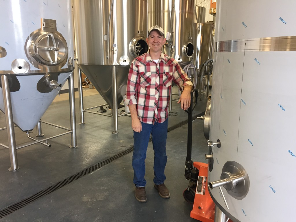 "Co-brewmaster and co-founder of 54-40 Brewing in Washougal, WA, Bolton ""Bolt"" Minister with some new brewing tanks freshly arrived from Practical Fusion"