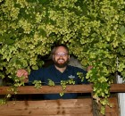 Laurelwood's Shane Waterson surrounded by his favorite plant (photo courtesy of Laurelwood Brewing)
