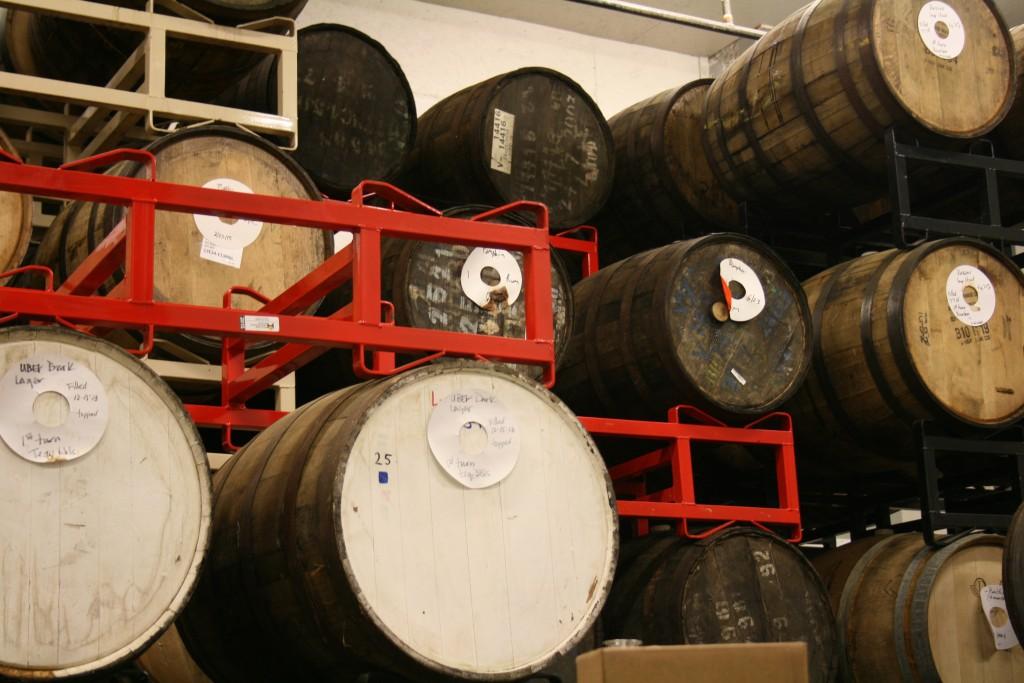 Barrel aging room at 10 Barrel Brewing