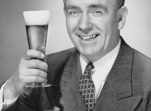 UNITED STATES - CIRCA 1950s:  Mature businessman with beer.  (Photo by George Marks/Retrofile/Getty Images)