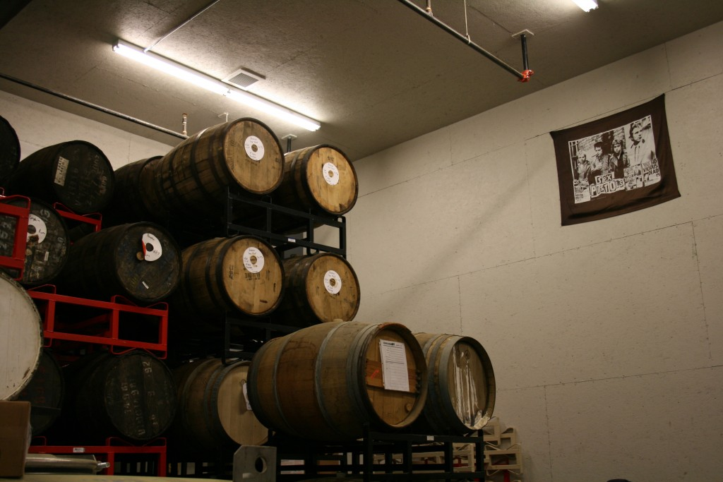 Sex Pistols look over the aging barrels at 10 Barrel Brewing