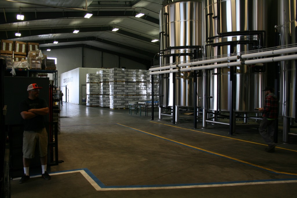 Stacks of 10 Barrel Apocolyps and walk in cooler in latest 10K square foot addition