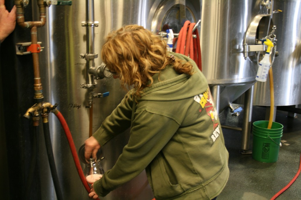 Tonya Cornett of 10 Barrel Brewing pouring a Crush from the zwickle