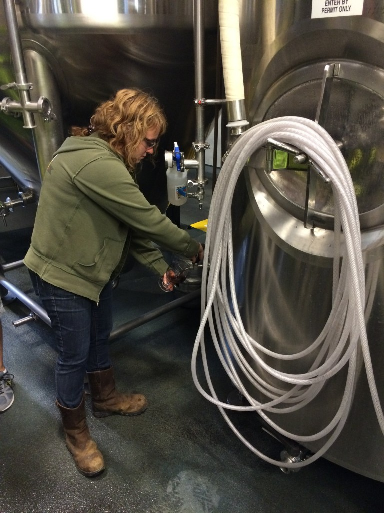 Tonya Cornett pouring from the zwickel at 10 Barrel Brewing