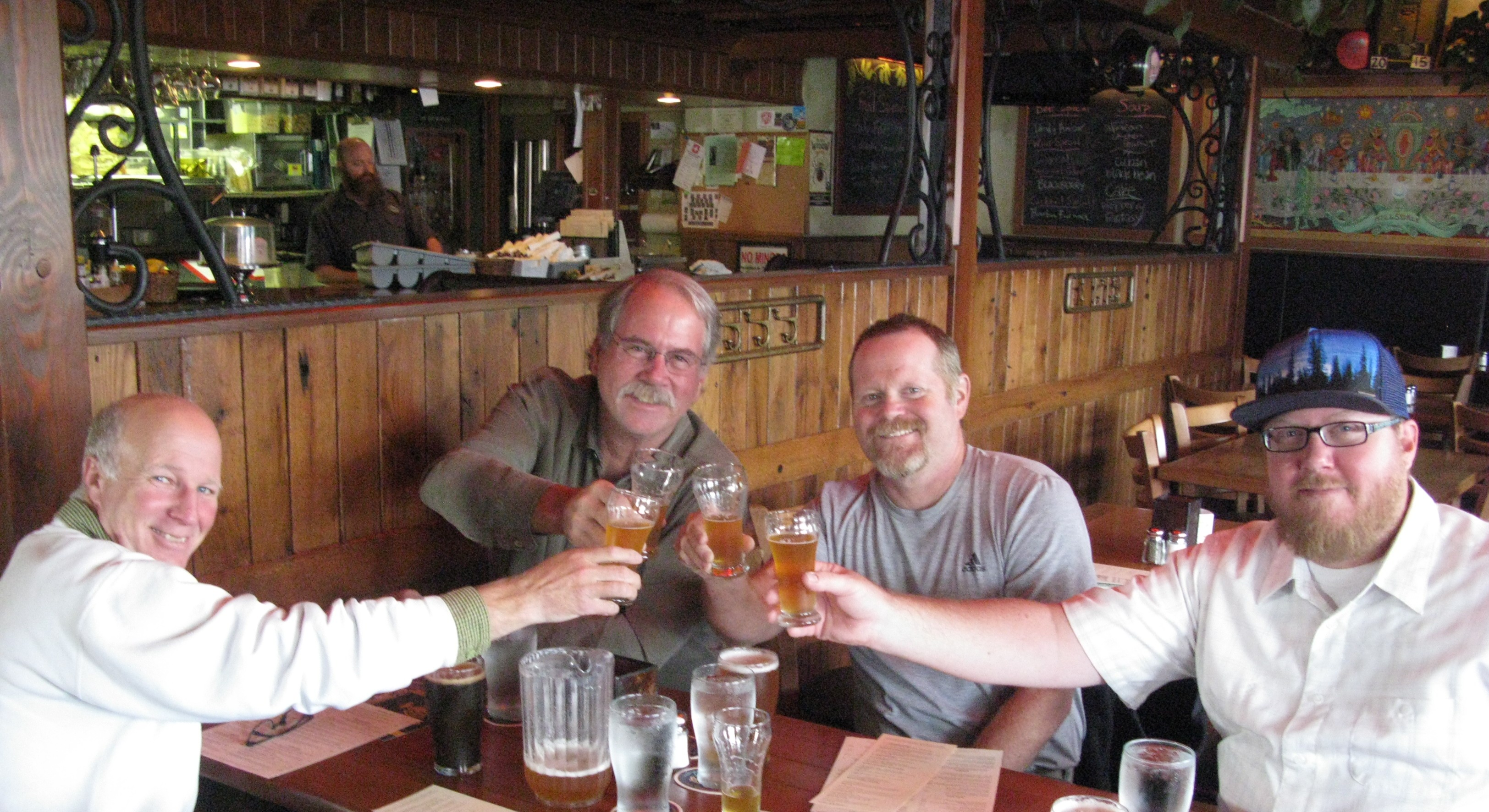 Brian McMenamin, second from left, raises a toast with pub GM Blair Hampson, McMenamins brewery boss Rob Vallance and district brewery manager Graham Brogan,. They were drinking the newly brewed Hillsdale Ale, a new interpretation of the first beer made in Oregon's first brewpub. The original Hillsdale Ale was brewed 30 years ago Sunday at McMenamins Hillsdale pub and the company engaged in some serious arch-ale-ology to reproduce that first recipe -- but in an updated form, because the first McMenamins beers used malt extract, because malsters sold malted barley by the ton and not the bag back in the early days of craft brewing. Celebrate Oergon's first brewpub brewed beer Sunday at all McMenamins locations -- thay'll all be pouring Hillsdale Ale for the special price of $4 a pint or $8 for a growler fill... FoystonFoto