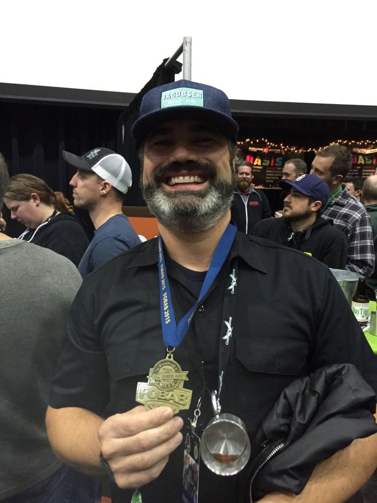 Charlie Frye of MetalCraft receives GIgantic Brewing's Gold Medal for Pipewrench at 2015 FoBAB