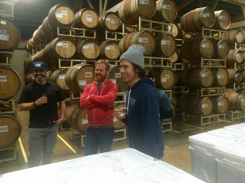 Eric Ponce (right) leading a tour at Goose Island Barrel Warehouse with Charlie Frye (left) of MCF Craft Brewing Systems and Tim Marshall (center) of Solemn Oath Brewing