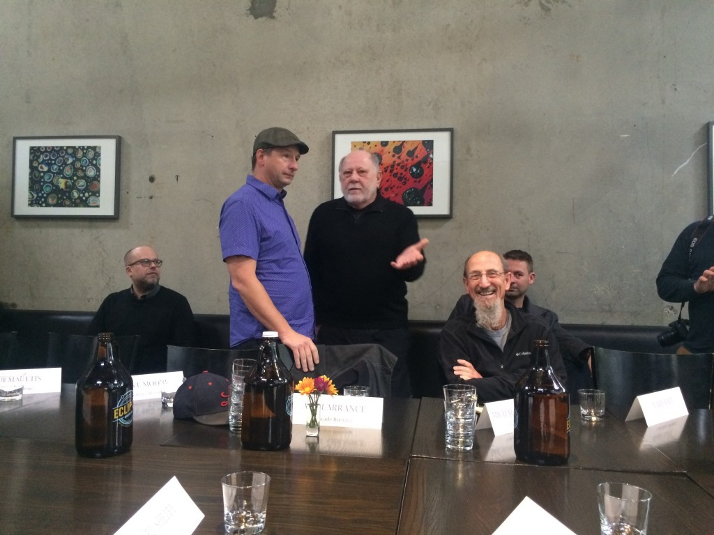 Jamie Floyd and Art Larrance talking before Sen. Ron Wyden and his brewers roundtable at Ecliptic Brewing