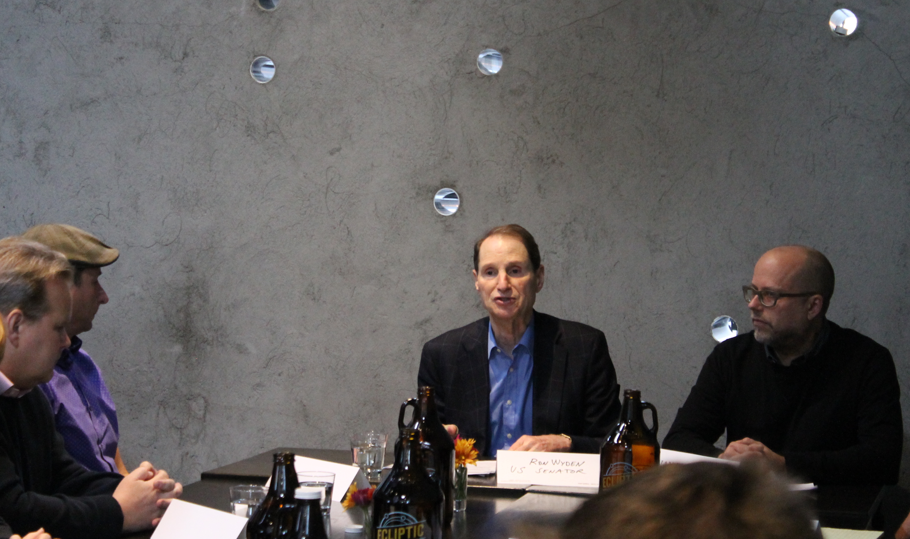 Senator Ron Wyden (center) and Brian Butenschoen, Executive Director of the Oregon Brewers Guild (right) at Wyden's brewers roundtable at Ecliptic Brewing.