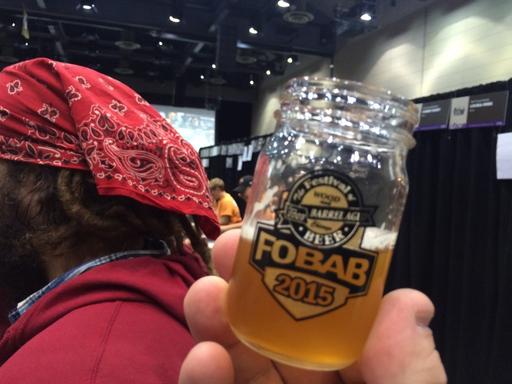 Trinity Brewing Red Swingline on Apricots and Peaches with Jason Yester in the background at 2015 FoBAB
