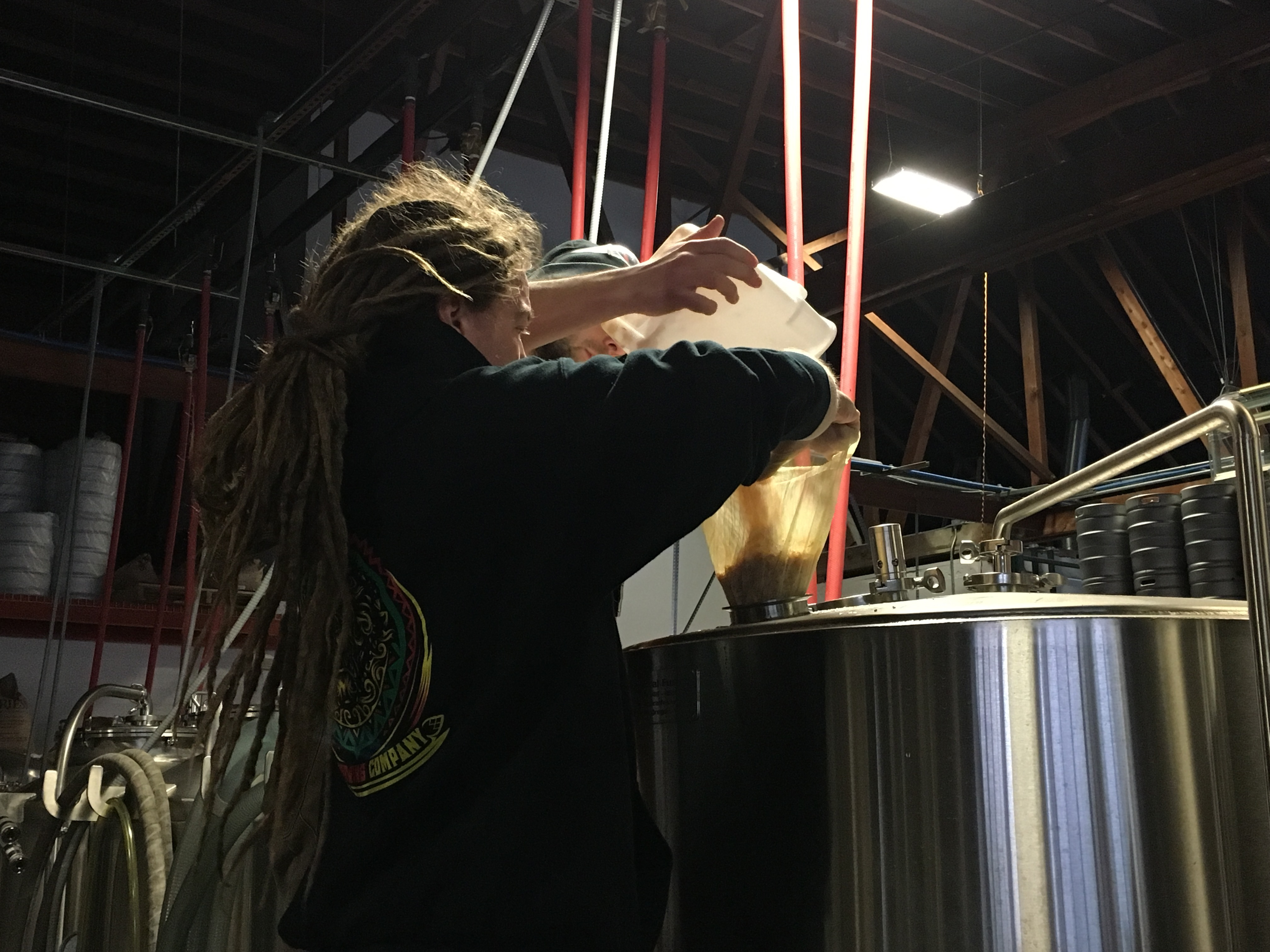 Erick Russ adding more toasted coconut to Pono Brewing's Toasted Coconut Cream Ale