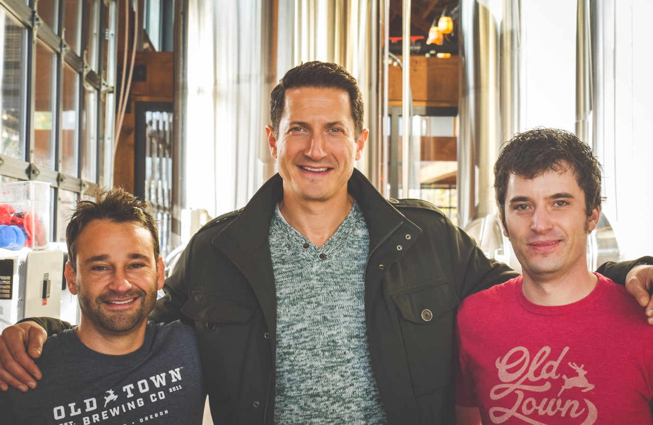 Grimm Old Town Doernbecher (Old Town Brewing's Adam Milne and Andrew Lamont surround Grimm's Sasha Roiz (photo courtesy of Old Town Brewing)