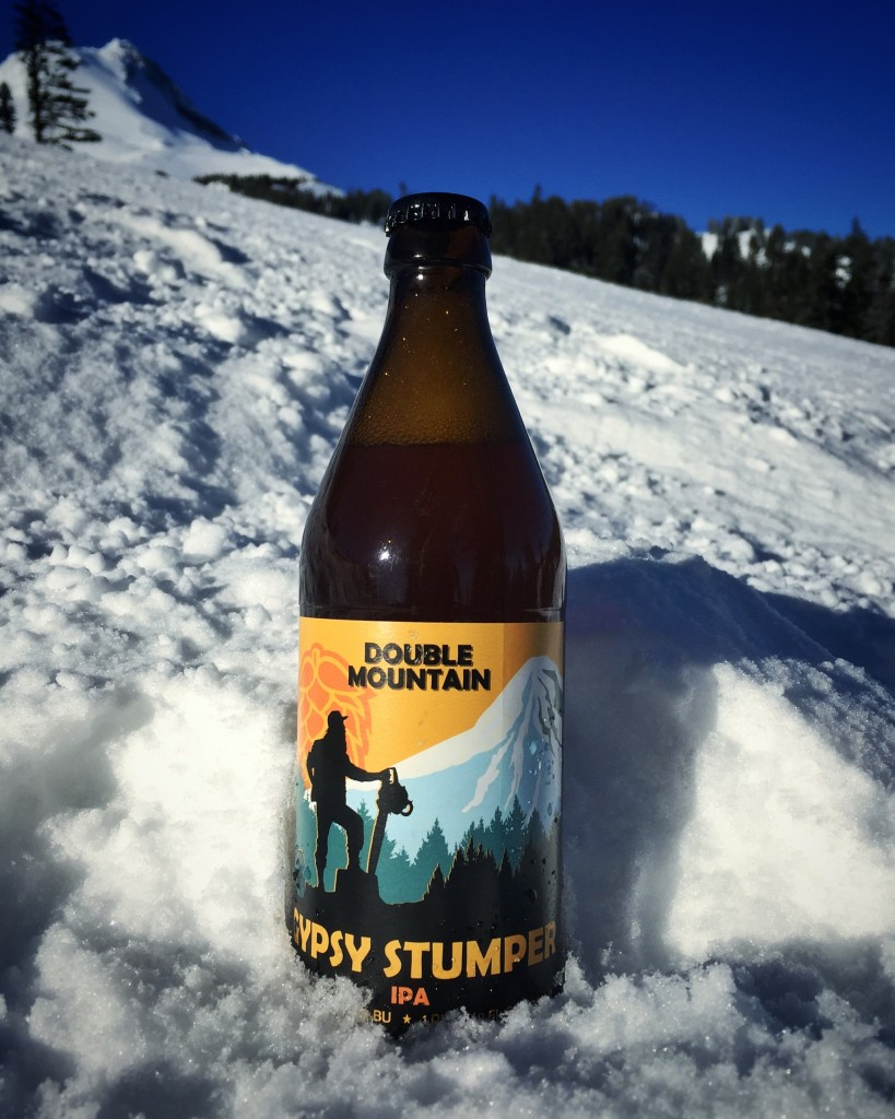 "Double Mountain's Gypsy Stumper IPA should be on shelves now: According to Double Mountain head brewer Kyle Larsen, the brewery's approch to its Gypsy Stumper IPA was to create an IPA layered in flavors with a little punch to it. ""While many of our beers employ a minimalist approach,"" Larsen said, ""Gypsy most certainly does not. Pilsner and Vienna malts make up the majority of the malt bill while Mosaic, Simcoe, Challenger, and Centennial hops intertwine to craft a wonderfully hop forward brew, with different flavors stratified throughout.It's sturdy and assertive enough to get you through cutting down tree stumps. However, we don't condone the use of an axe or chainsaw while enjoying."" Gypsy Stumper IPA weighs in at 7.5 percent and 80 IBU. The name? ""In the spring of 1980, a bearded, ragtag work-crew known as Gypsy Stumpers were hired to clear stumps out of the new runs on Hood River Meadows. Camped at lift tower 10, they worked long hours falling trees six feet in diameter, but only three feet tall. Much like the stumpers, this beer works twice as hard for your riding pleasure. Tangerine and herbal flower notes make their way through the resinous, pine forest nose. Its sturdy body holds the weight of the vigorous hopping, resulting in an assertive balance."" bottle pic courtesy Double Mountain Brewing"