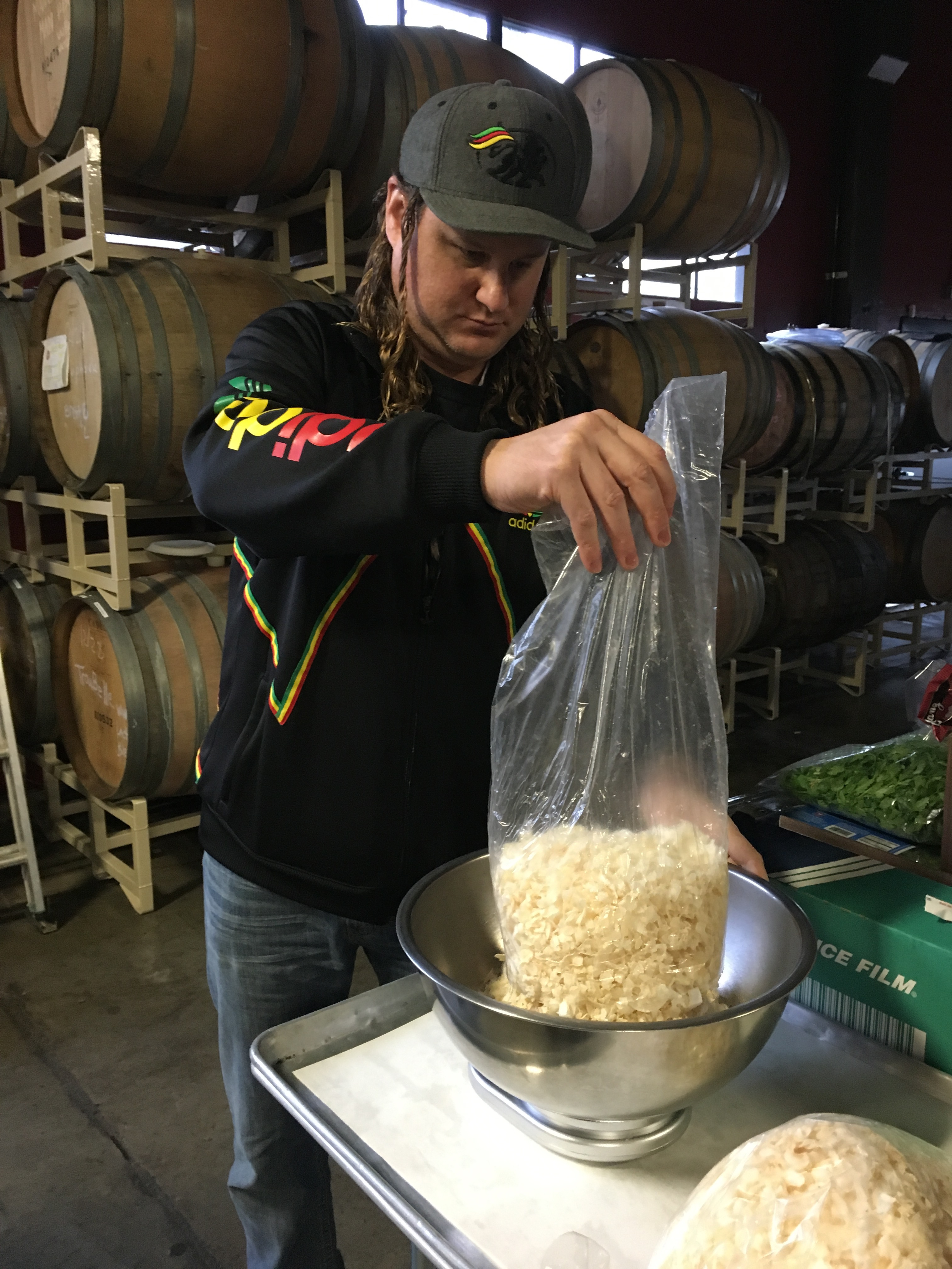 Larry Clouser of Pono Brewing weighing out coconut