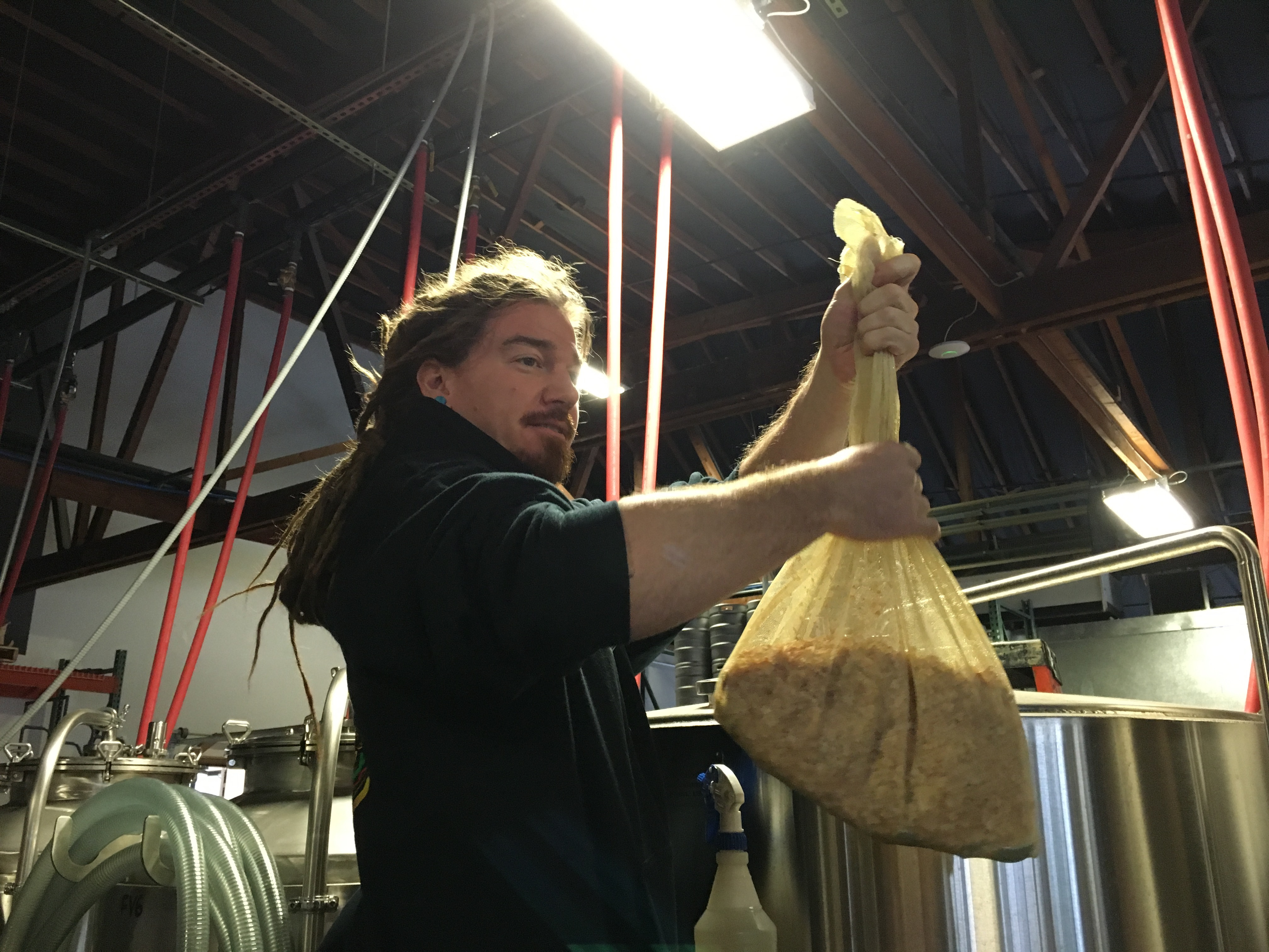 Pono Brewing's Erick Russ getting ready to place a bag of toasted coconut to finish Toasted Coconut Cream Ale