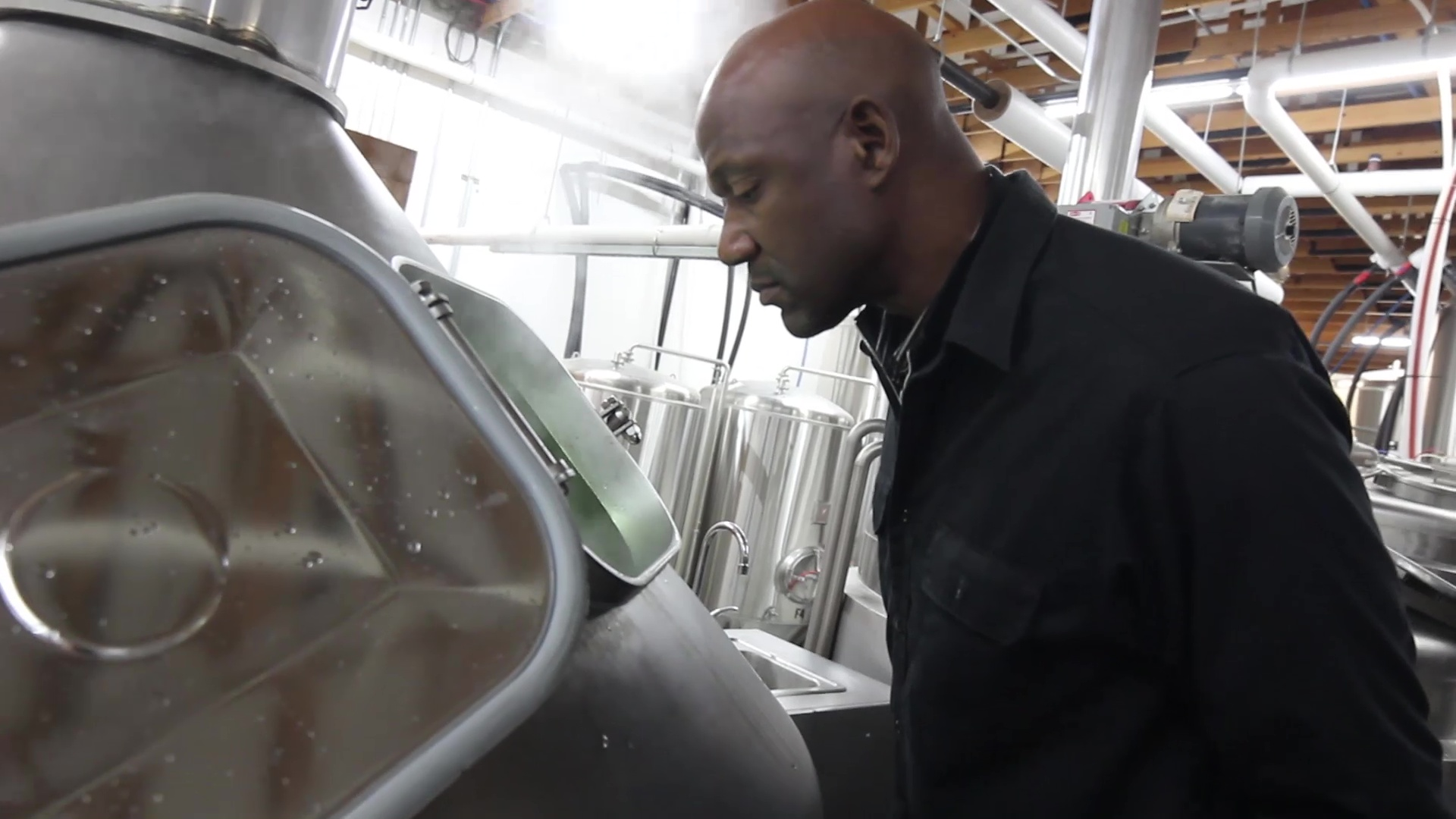 Terry Porter at the brew kettle. (image courtesy of Gilgamesh Brewing)