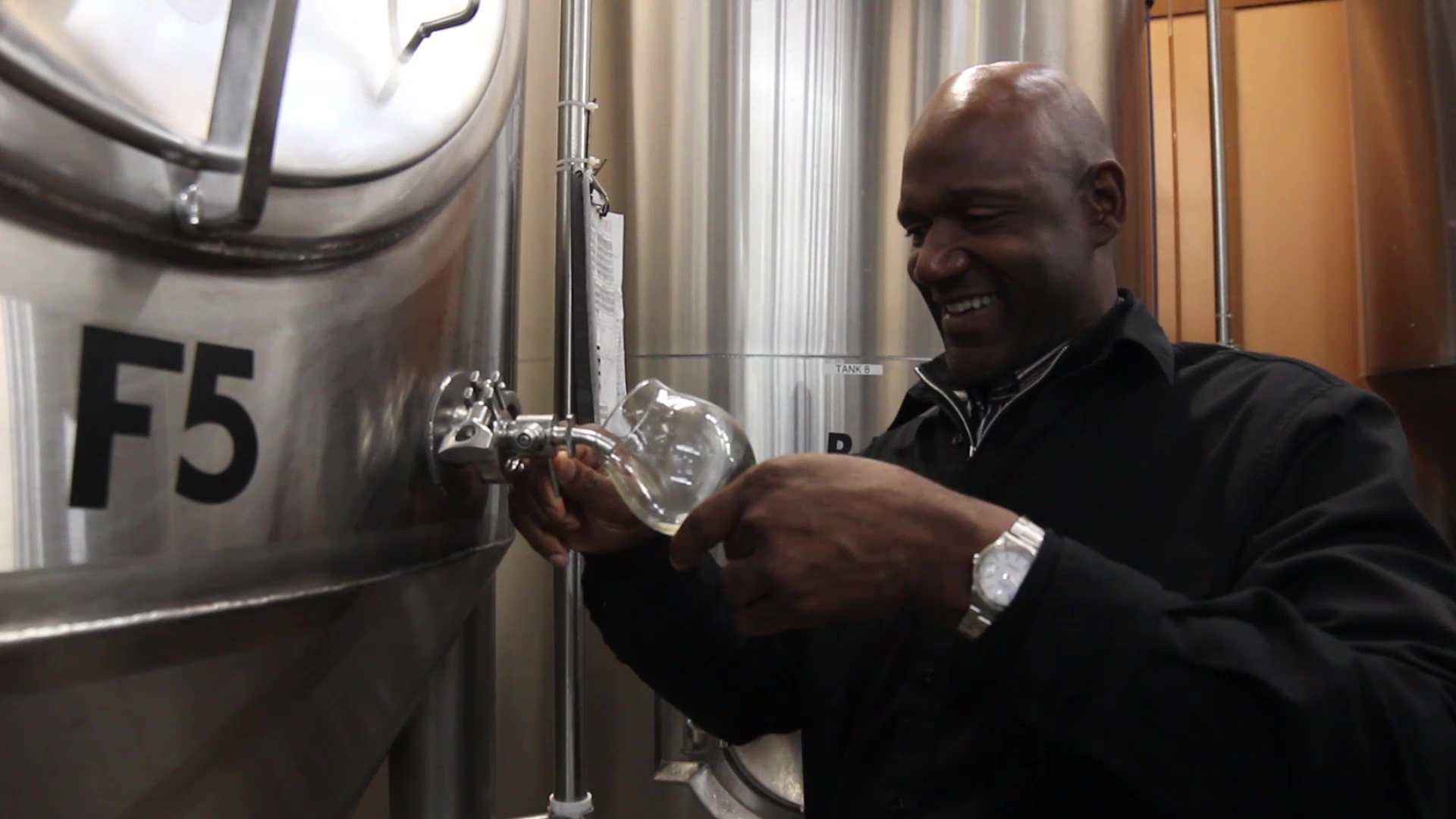 Terry Porter pouring from the zwickel. (image courtesy of Gilgamesh Brewing)