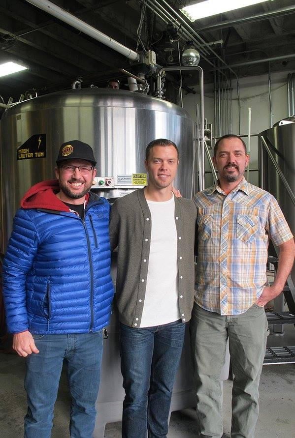 Hopworks Urban Brewery founder Christian Ettinger with Portland Timber Jack Jewsbury and Head Brewer Tom Bleigh. (image courtesy of Hopworks Urban Brewery)