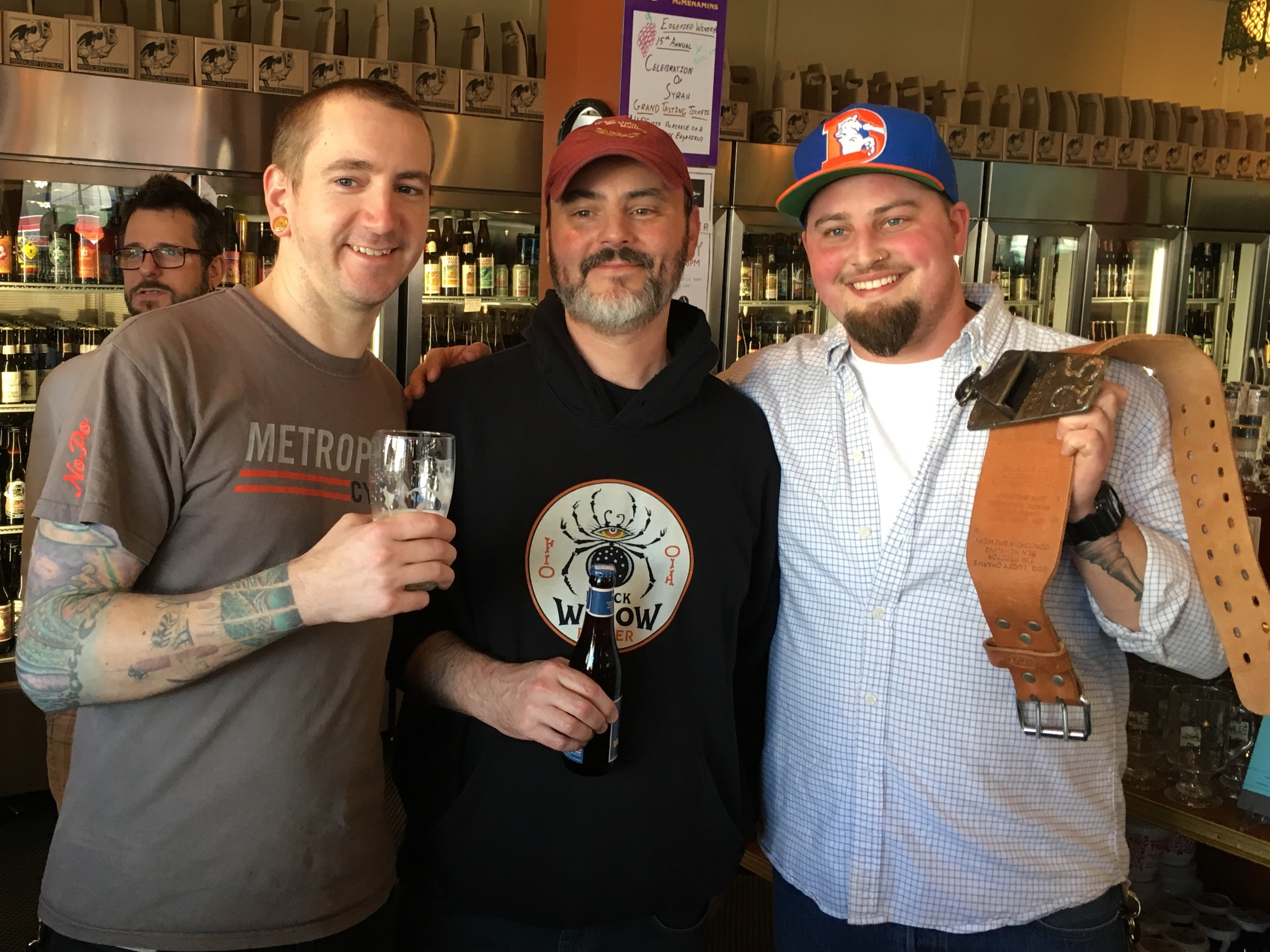 Jesse Grover of McMenamins On The Columbia (right), winner of the 2016 Battle For The Belt pictured alongside Matt Carver (center) and Dave Kosanke (left) from Kennedy School Concordia Brewery at 23rd Avenue Bottle Shop.