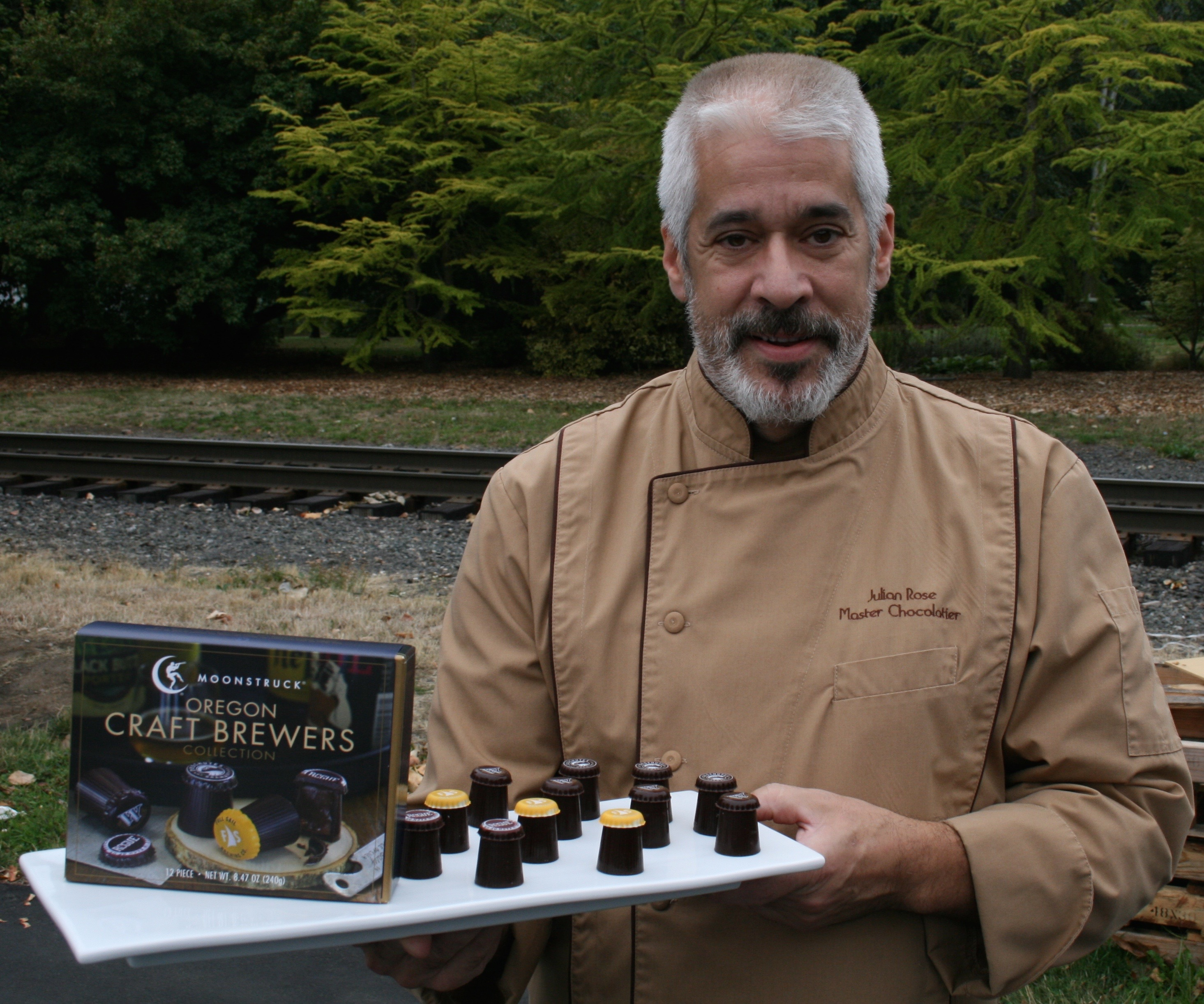 Julian Rose displaying his Moonstruck Chocolate Oregon Craft Brewers Collection Truffles. (photo by D.J. Paul)