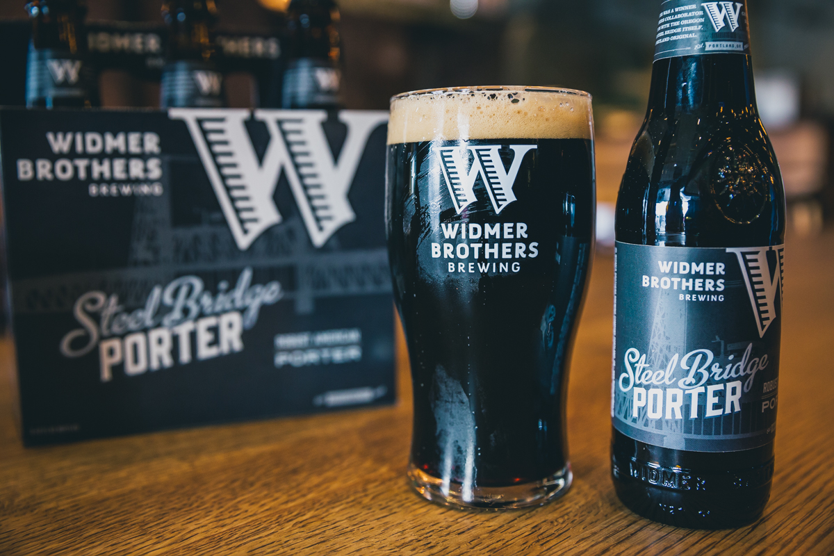 Yes, the days are getting brighter, but a good, dark porter is still a welcome beer and they don't get any better than Widmer Steel Bridge Porter, which began life 15 years ago as a Collaboration series beer designed by Noel Blake. Since then, Widmer has occasionally brewed small draught-only batches of Steel Bridge Porter and in 2013 expanded the beer's availability to 22-ounce bottles . In what was supposed to be a one-time run exclusively for the Portland market, the hoppy, robust porter proved it had staying power and continued to be bottled for the Oregon market for two years. Based on increasing demand, Widmer has just reintroduced the beer with a bold new look to match its big flavor, and you should be able to find sixers of the bottles with the new labels just about everywhere.