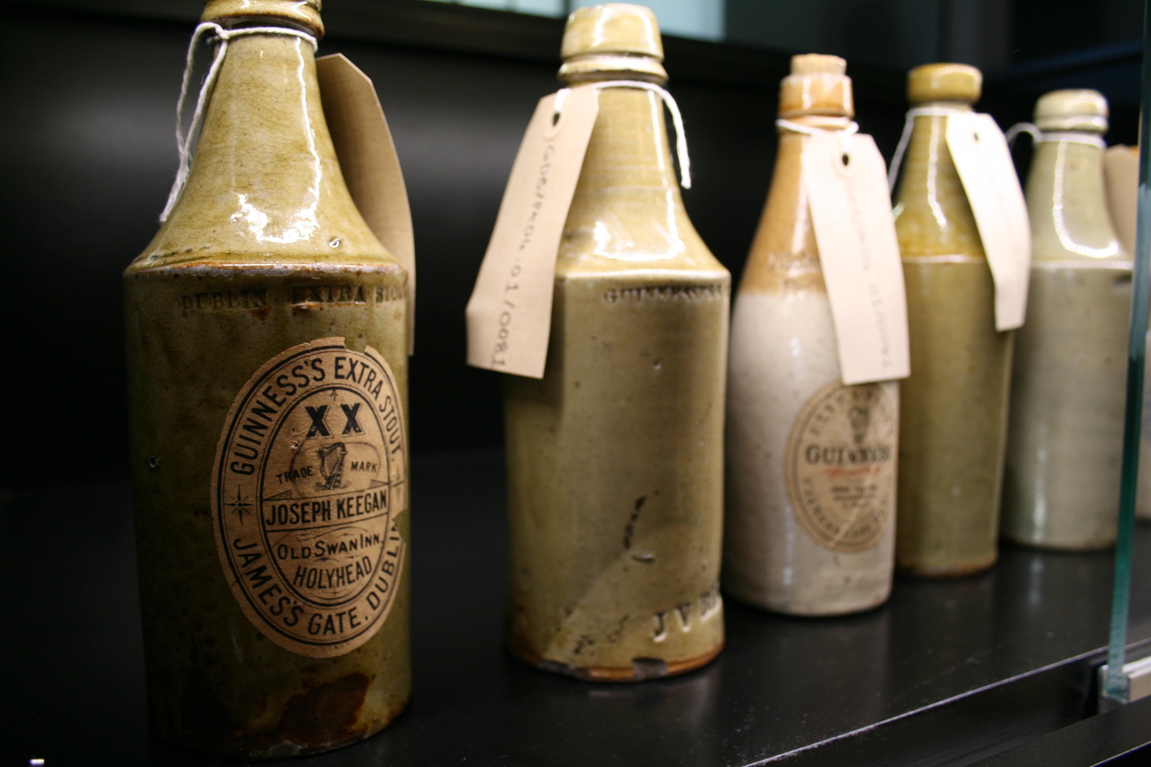 Old ceramic bottles of Guinness in the Guinness Archives.