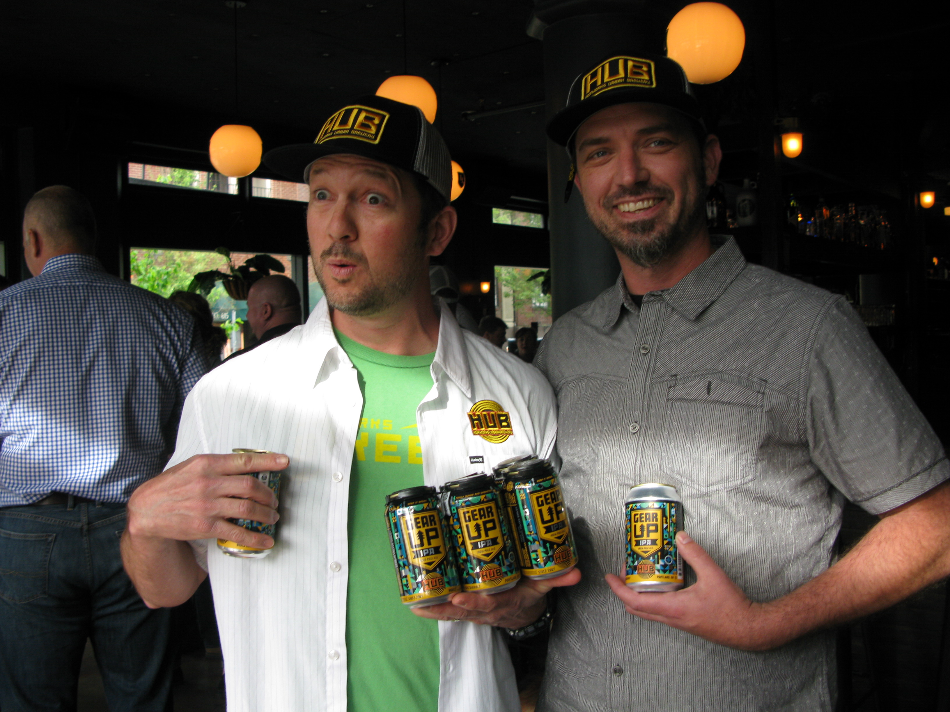 Tom Bleigh (right) and founder Christian Ettinger show off the culmination of six months of work – Hopworks new Gear Up IPA, a Northwest-Style IPA with a dry and tropical-hop profile.