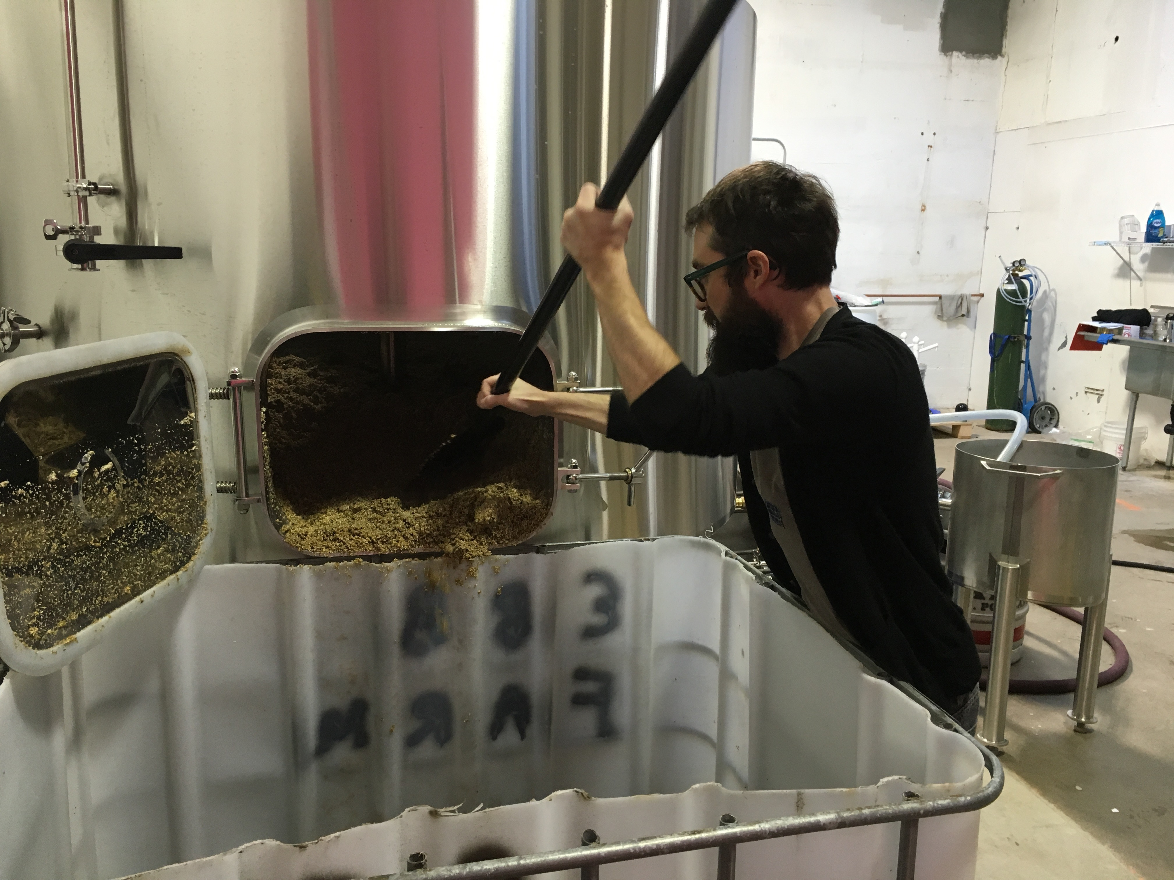Roayle Brewing head brewer Paul Rey taking care of the spent grain after his first brew on St. Patrick's Day.